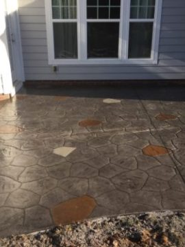 speckles stamped concrete stone patio