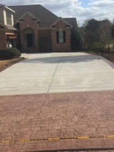concrete driveway with bricks