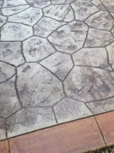 stamped concrete with decorative curb